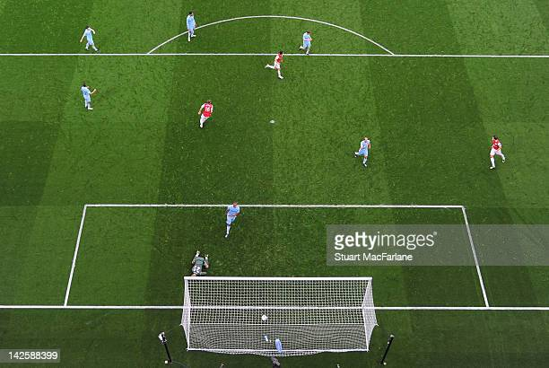 Mikel Arteta of Arsenal shoots past Manchester City goalkeeper Joe Hart to score the only goal of the match during the Barclays Premier League match...
