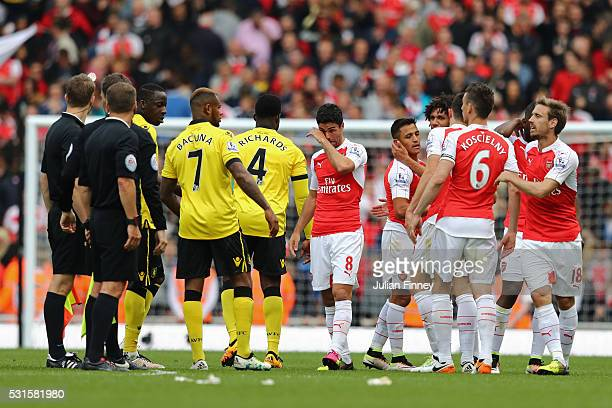 Mikel Arteta of Arsenal shows his emotion after the Barclays Premier League match between Arsenal and Aston Villa at Emirates Stadium on May 15 2016...