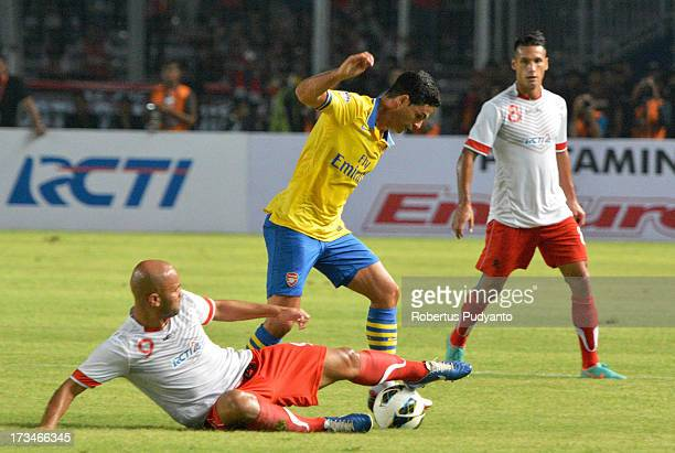 Mikel Arteta of Arsenal trying to avoid tackling of Indonesian's during the match between Arsenal and the Indonesia AllStars at Gelora Bung Karno...