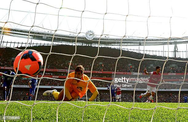 Mikel Arteta of Arsenal turns away to celebrate after scoring his team's second goal from the penalty spot past goalkeeper Joel Robles of Everton...