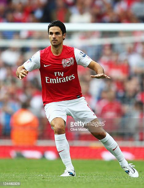 Mikel Arteta of Arsenal warms up prior to the Barclays Premier League match between Arsenal and Swansea City at Emirates Stadium on September 10 2011...