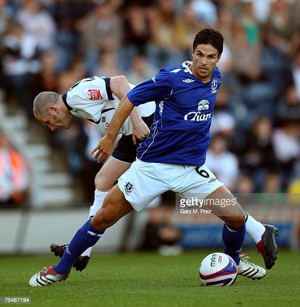 Mikel Arteta of Everton and Kevin Nicholls of Preston North End in action during the Friendly match between Preston North End and Everton at Deepdale...