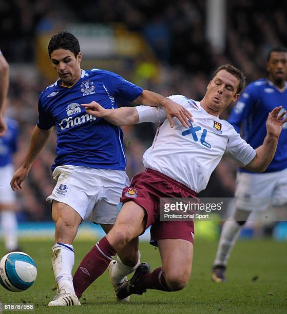 Mikel Arteta of Everton battles with Scott Parker of West Ham during the Barclays Premier League match between Everton and West Ham United at...