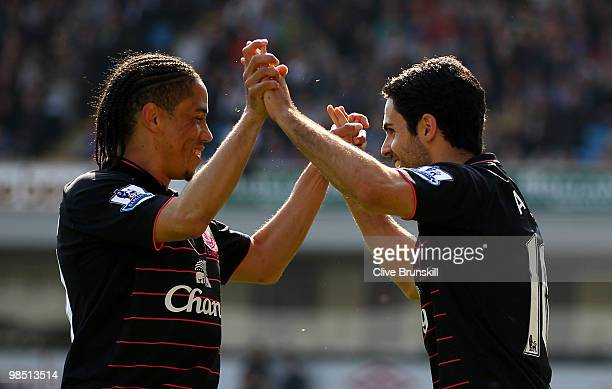 Mikel Arteta of Everton celebrates with Steven Pienaar after scoring the first goal from the penalty spot during the Barclays Premier League match...