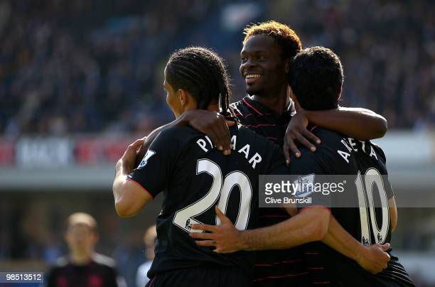 Mikel Arteta of Everton celebrates with Steven Pienaar and Louis Saha after scoring the first goal from the penalty spot during the Barclays Premier...