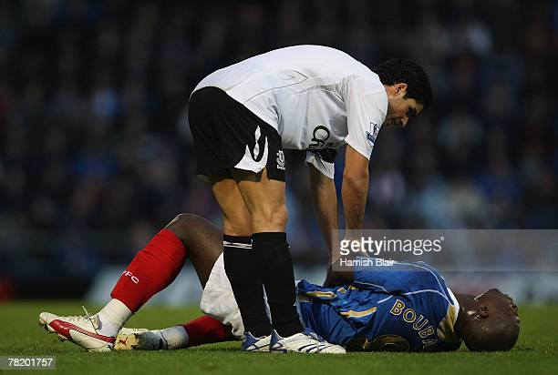 Mikel Arteta of Everton checks on Papa Bouba Diop of Portsmouth during the Barclays Premier League match between Portsmouth and Everton at Fratton...