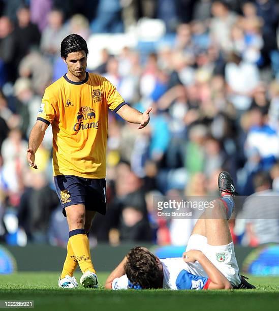 Mikel Arteta of Everton consoles a dejected Gael Givet of Blackburn Rovers at fulltime following the Barclays Premier League match between Blackburn...
