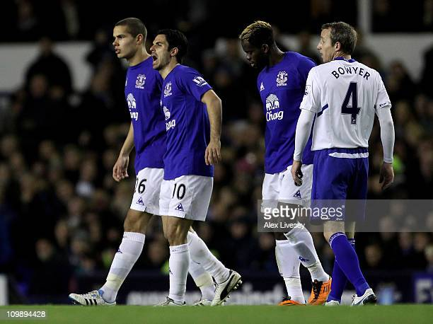 Mikel Arteta of Everton grimaces after sustaining an injury during the Barclays Premier League match between Everton and Birmingham City at Goodison...