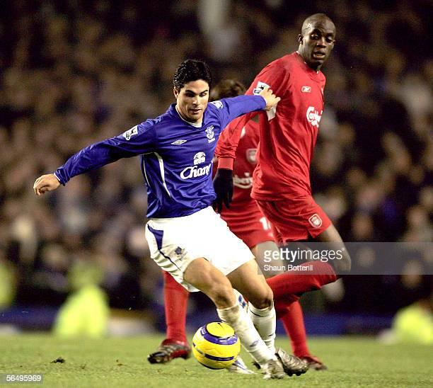 Mikel Arteta of Everton holds off a challenge from Momo Sissoko of Liverpool during the Barclays Premiership match between Everton and Liverpool at...