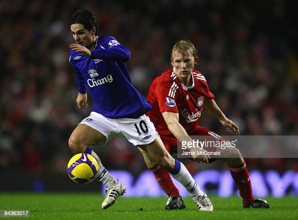Mikel Arteta of Everton moves away from Dirk Kuyt of Liverpool during the Barclays Premier League match between Liverpool and Everton at Anfield on...