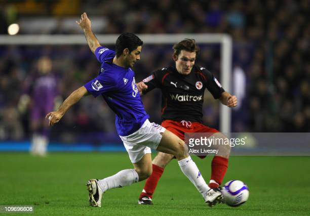 Mikel Arteta of Everton passes the ball under pressure from Jay Tabb of Reading during the FA Cup 5th round match sponsored by Eon between Everton...