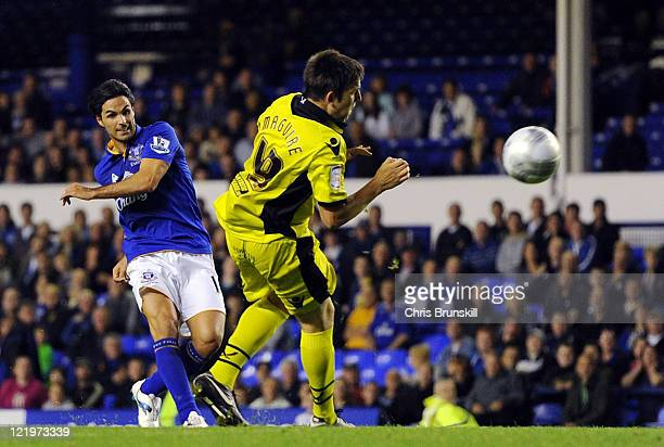 Mikel Arteta of Everton scores his side's third goal during the Carling Cup Second Round match between Everton and Sheffield United at Goodison Park...