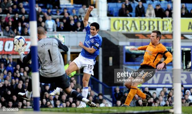 Mikel Arteta of Everton scores the opening goal past Boaz Myhill of Hull during the Barclays Premier League match between Everton and Hull City at...