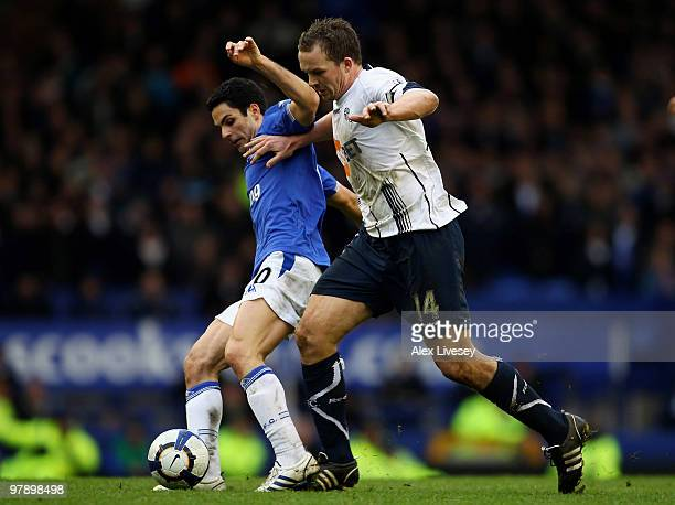 Mikel Arteta of Everton tackles Kevin Davies of Bolton Wanderers during the Barclays Premier League match between Everton and Bolton Wanderers at...