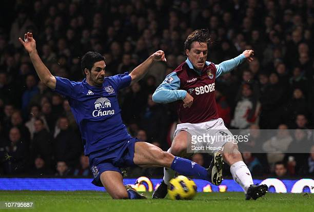 Mikel Arteta of Everton tackles Scott Parker of West Ham United during the Barclays Premier League match between West Ham United and Everton at the...