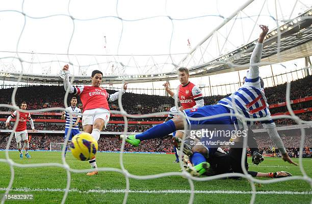 Mikel Arteta shoots the ball past QPR defender Ryan Nelson to score the only goal of the game during the Barclays Premier League match between...