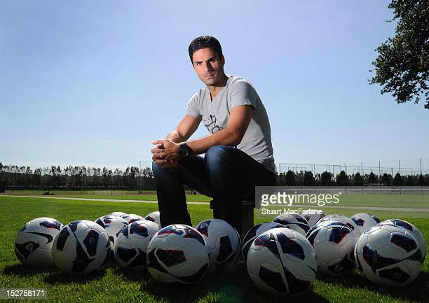 Mikel Arteta takes part in a photoshoot at the Arsenal Training Ground, London Colney on September 5, 2012 in St Albans, England.