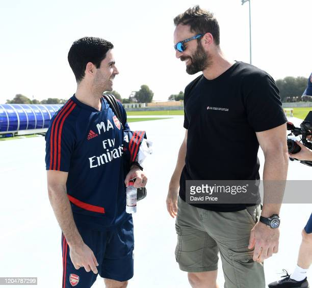 Mikel Arteta the Arsenal Head Coach says hello to Manuel Almunia the former Arsenal Goalkeeper after the Arsenal Training Session on February 08,...