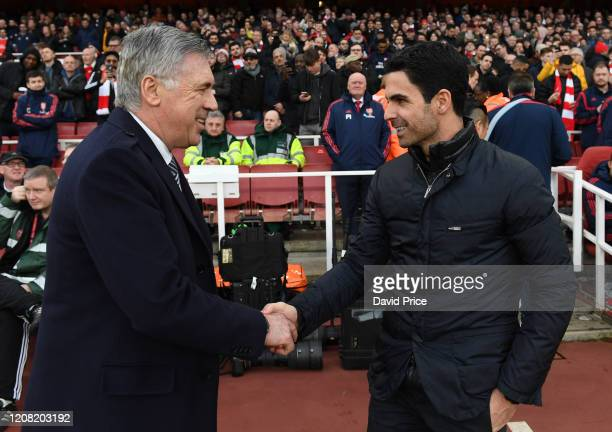 Mikel Arteta the Arsenal Head Coach shakes hands with Carlo Ancelotti the Manager of Everton the Premier League match between Arsenal FC and Everton...