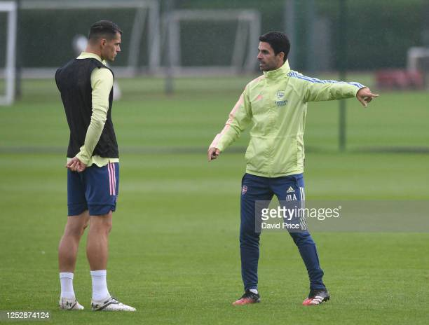 Mikel Arteta the Arsenal Head Coach with Granit Xhaka of Arsenal during the Arsenal 1st team training session at London Colney on June 27, 2020 in St...