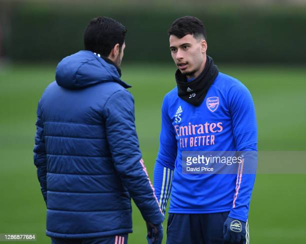 Mikel Arteta the Arsenal Manager talks to Gabriel Martinelli of Arsenal during the Arsenal 1st team training session at London Colney on November 21...