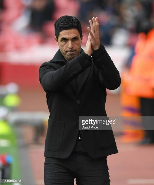 Mikel Arteta the Manager of Arsenal claps the fans before the Premier League match between Arsenal and Brighton & Hove Albion at Emirates Stadium on...