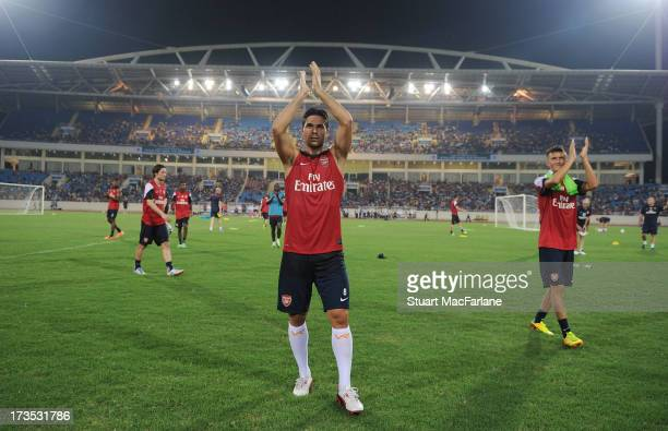 Mikel Arteta waves to the Arsenal fans after a training session in Hanoi for the club's preseason Asian tour at the My Dinh National Stadium on July...