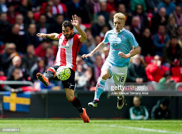 Mikel Balenziaga of Athletic Club Bilbao competes for the ball with Daniel Wass of RC Celta de Vigo during the La Liga match between Athletic Club...