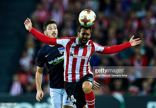 Mikel Balenziaga of Athletic Club duels for the ball with Matthew Leckie of Hertha BSC during the UEFA Europa League group J match between Athletic...