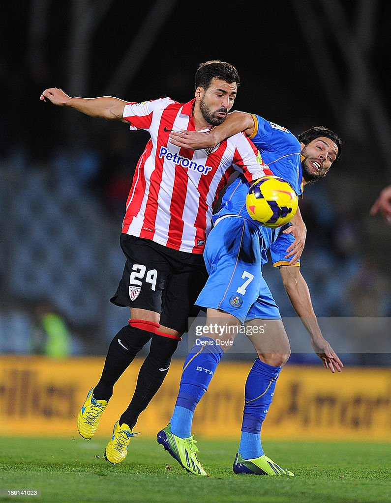 Mikel Belenziaga (L) of Athletic Club battles for the ball against Angel Lafita of Getafe CF battles for the ball against during the La Liga match between Getafe CF and Athletic Club at Coliseum Alfonso Perez stadium on October 28, 2013 in Getafe, Spain.