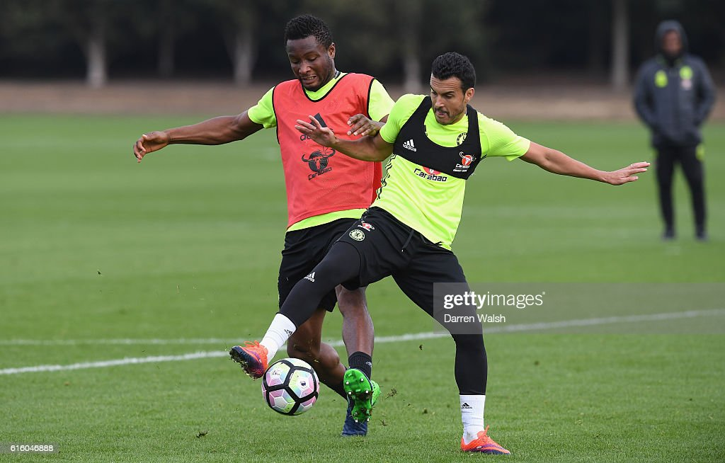 Mikel John Obi and Pedro of Chelsea during a training session at Chelsea Training Ground on October 21, 2016 in Cobham, England.
