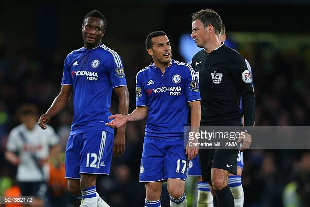Mikel John Obi and Pedro of Chelsea talk to Referee Mark Clattenburg during the Barclays Premier League match between Chelsea and Tottenham Hotspur...