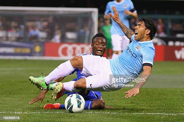 Mikel John Obi of Chelsea trips Carlos Tevez of Manchester City during a friendly match at Busch Stadium on May 23 2013 in St Louis Missouri