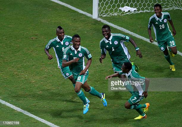 Mikel John Obi of Nigeria celebrates with his teammates after scoring his team's first goal during the FIFA Confederations Cup Brazil 2013 Group B...