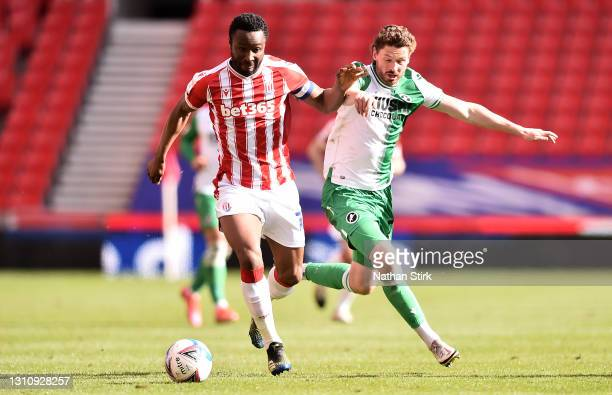 Mikel John Obi of Stoke City battles for possession with George Evans of Millwall FC during the Sky Bet Championship match between Stoke City and...
