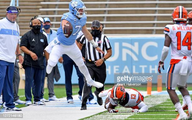Mikel Jones of the Syracuse Orange knocks Sam Howell of the North Carolina Tar Heels out of bounds during the fourth quarter of their game at Kenan...