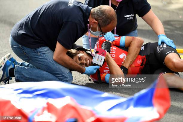 Mikel Landa Meana of Spain and Team Bahrain Victorious are involved in an accident and is assisted by the medical team during the 104th Giro d'Italia...
