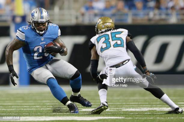 Mikel Leshoure of the Detroit Lions looks to get around Demetrius McCray of the Jacksonville Jaguars in the third quarter during a preseason game at...