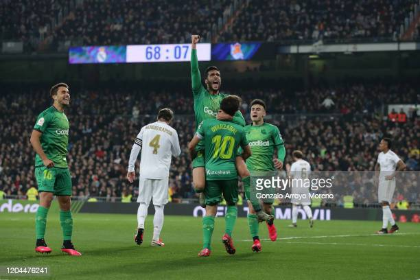 Mikel Merino celebrates scoring their fourth goal with teammates Ander Guevara , Mikel Oyarzabal and Ander Barrenetxea ahead Sergio Ramos of Real...