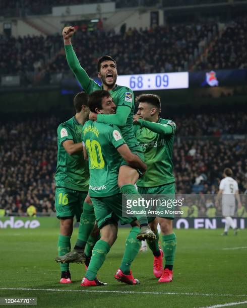 Mikel Merino celebrates scoring their fourth goal with teammates Ander Guevara , Mikel Oyarzabal and Ander Barrenetxea during the Copa del Rey...
