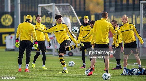 Mikel Merino of Dortmund and teammates warm up during a training session ahead of their Champions League match against Sporting CP at Dortmund...