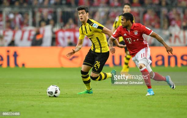 Mikel Merino of Dortmund challenges Douglas Costa of Bayern Muenchen during the Bundesliga match between Bayern Muenchen and Borussia Dortmund at...