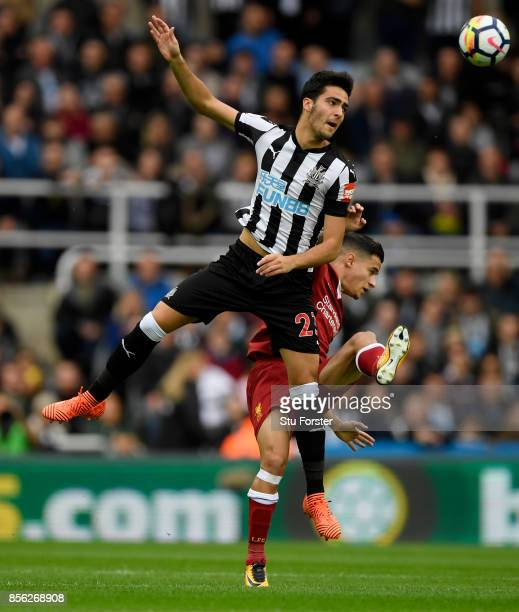 Mikel Merino of Newcastle United and Philippe Coutinho of Liverpool battle for possession in the air during the Premier League match between...