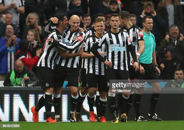 Mikel Merino of Newcastle United celebrates with team mates as he scores their first goal during the Premier League match between Newcastle United...