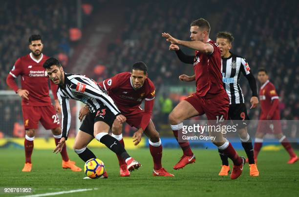 Mikel Merino of Newcastle United is closed down by Jordan Henderson of Liverpool during the Premier League match between Liverpool and Newcastle...