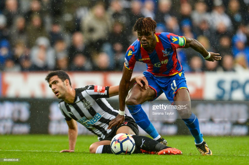 Mikel Merino of Newcastle United (23) is taken down by Wilfried Zaha of Crystal Palace (11) during the Premier League match between Newcastle United and Crystal Palace at St.James' Park on October 21, 2017, in Newcastle, England.