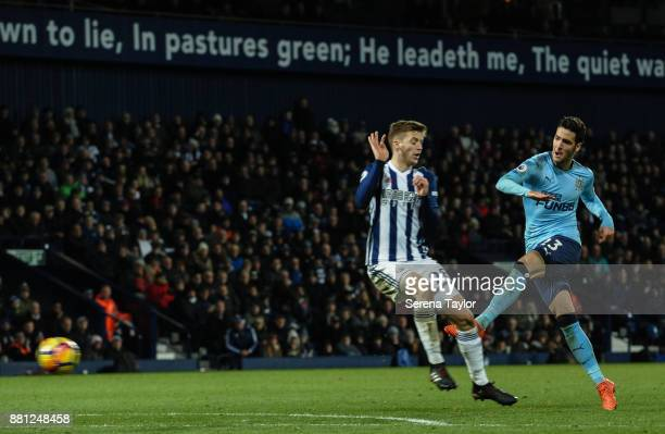 Mikel Merino of Newcastle United strikes the ball past Sam Field of West Bromwich Albion during the Premier League match between West Bromwich Albion...