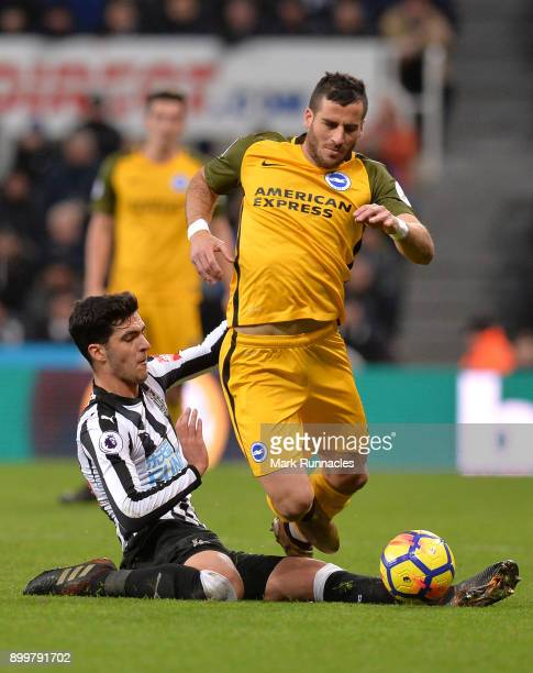 Mikel Merino of Newcastle United tackles Tomer Hemed of Brighton and Hove Albion during the Premier League match between Newcastle United and...