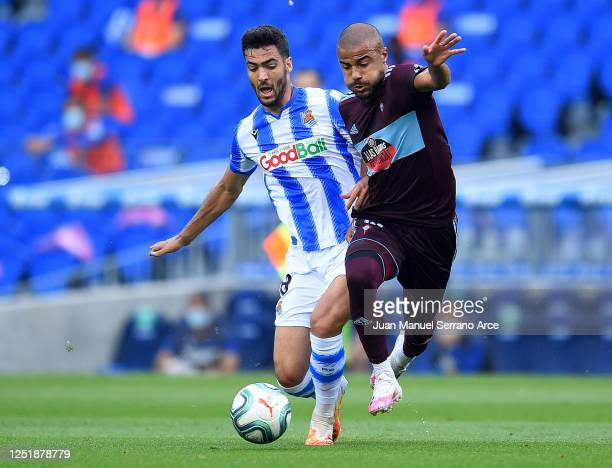 Mikel Merino of Real Sociedad and Rafinha of RC Celta de Vigo battle for the ball during the Liga match between Real Sociedad and RC Celta de Vigo at...