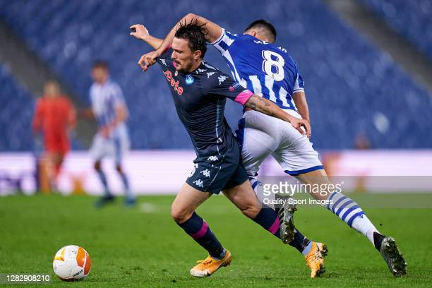 Mikel Merino of Real Sociedad battle for the ball with Mario Rui of SSC Napoli during the UEFA Europa League Group F stage match between Real...